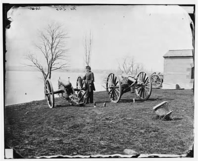 1957 - Washington, D.C. Two Wiard guns at the Arsenal; Gen. Daniel E. Sickles by the left-hand one › Page 1 - Fold3.com